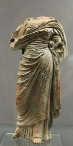Terracotta female figure wearing a chiton and himation, Cnidus, c. 330 BCE